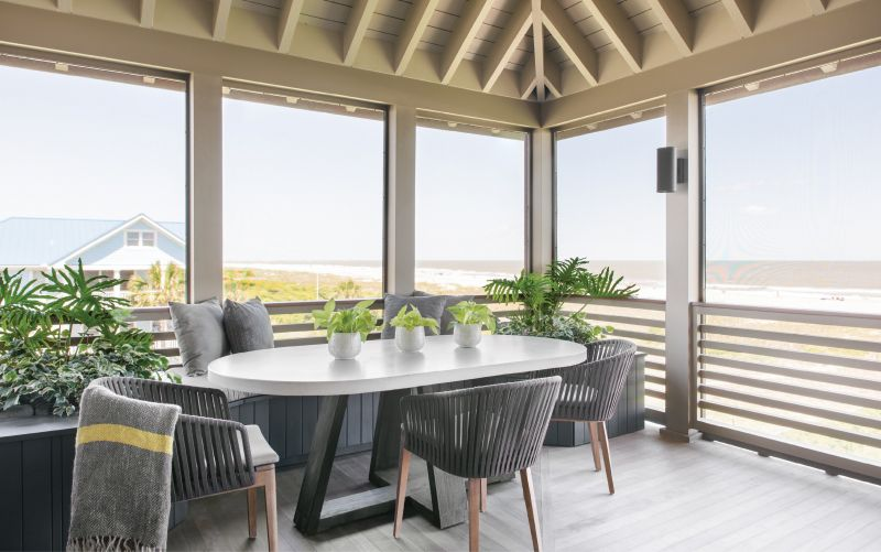 Viewfinder: With multiple porches, there's always somewhere to sit and soak up the views. But the dining porch, complete with a custom oval concrete and elm table by Clubcu and JANUS et Cie Mood chairs, tops them all.
