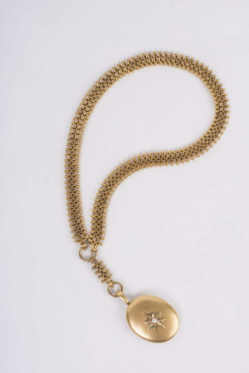 Estate 18K yellow gold bib necklace with 18K yellow gold Oval Pearl Locket, $7,175 at Croghan's Jewel Box