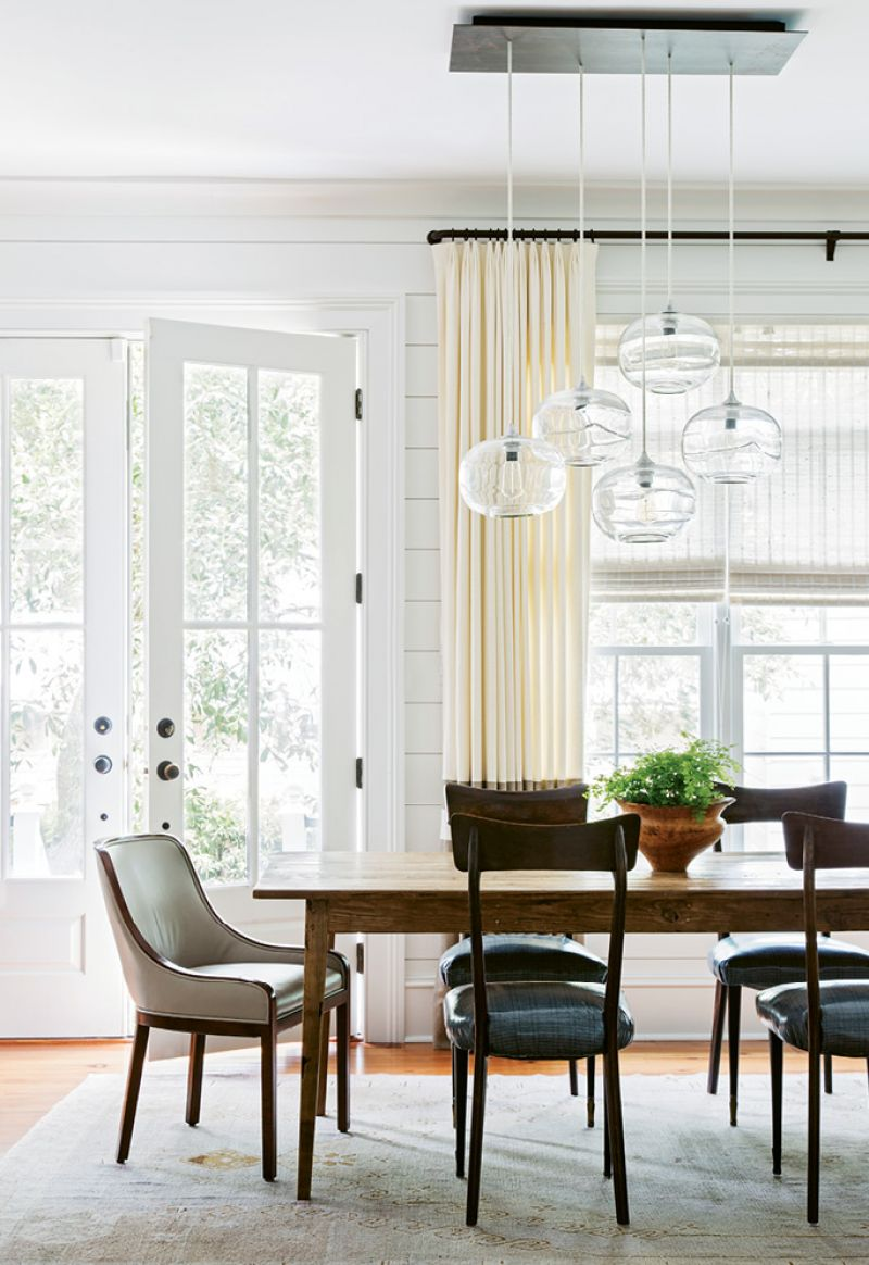 "IN THE SPOTLIGHT: Sculptural light fixtures, such as this hand-blown glass number by John Pomp, were added throughout. ""They're really like works of art,"" Melanie notes."