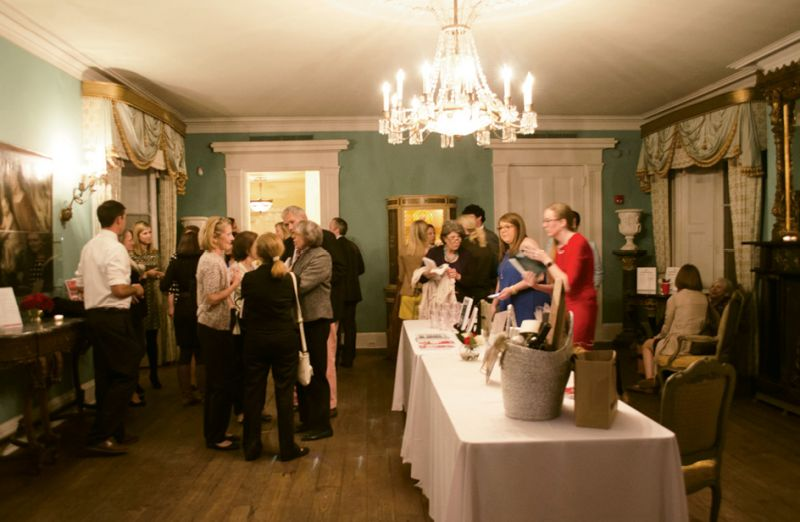 Attendees purchase copies in the parlor of the William Aiken House.