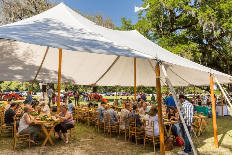 Tables in the outdoor tents were filled with colorful local produce.