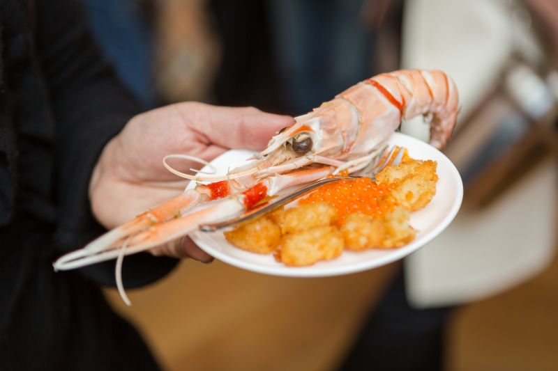 Guests ate their fill of langoustines and tater tots.