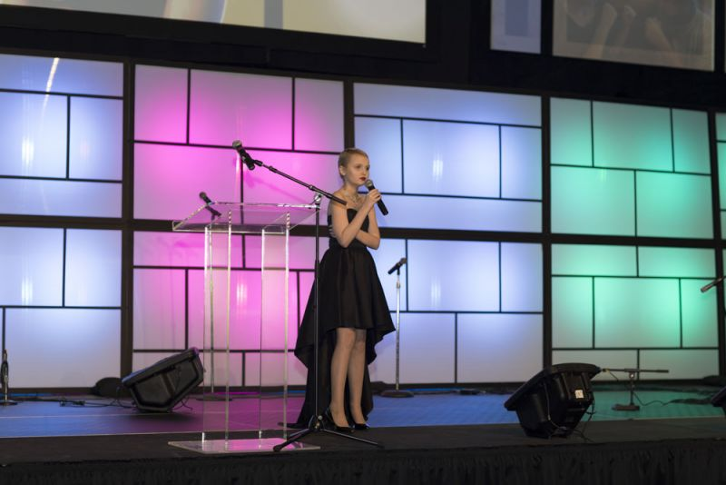 Morgan Pierce steps on stage to share her journey of childhood cancer.