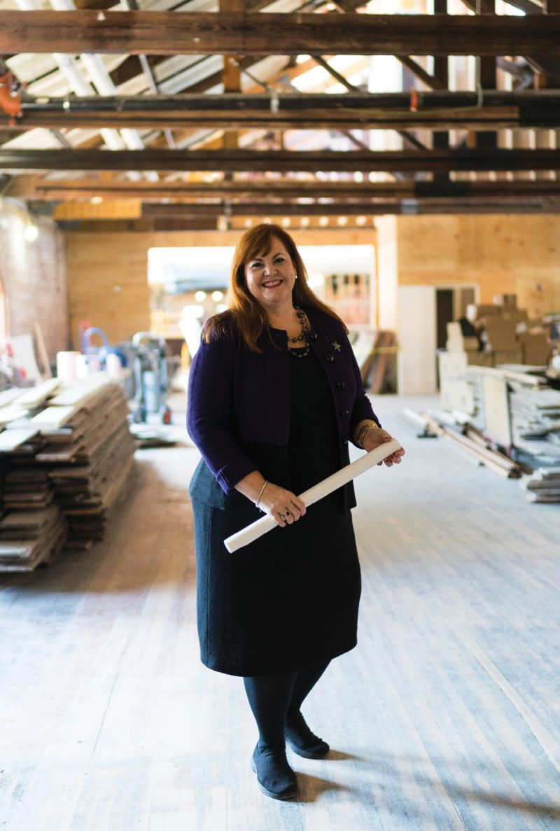 """Explore Charleston CEO Helen Hill at the Charleston Visitor Center, which is being redesigned to include interactive elements, such as a demo kitchen, that are inviting for visitors and locals alike, as well as messaging to help """"visitors understand that Charleston is a working city,"""" she says"""