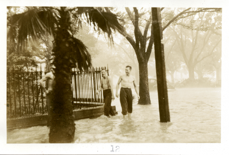 Wet Point Gardens: A hurricane in 1940 turned White Point Gardens into a waterway. Two men wade at the corner of Meeting and South Battery