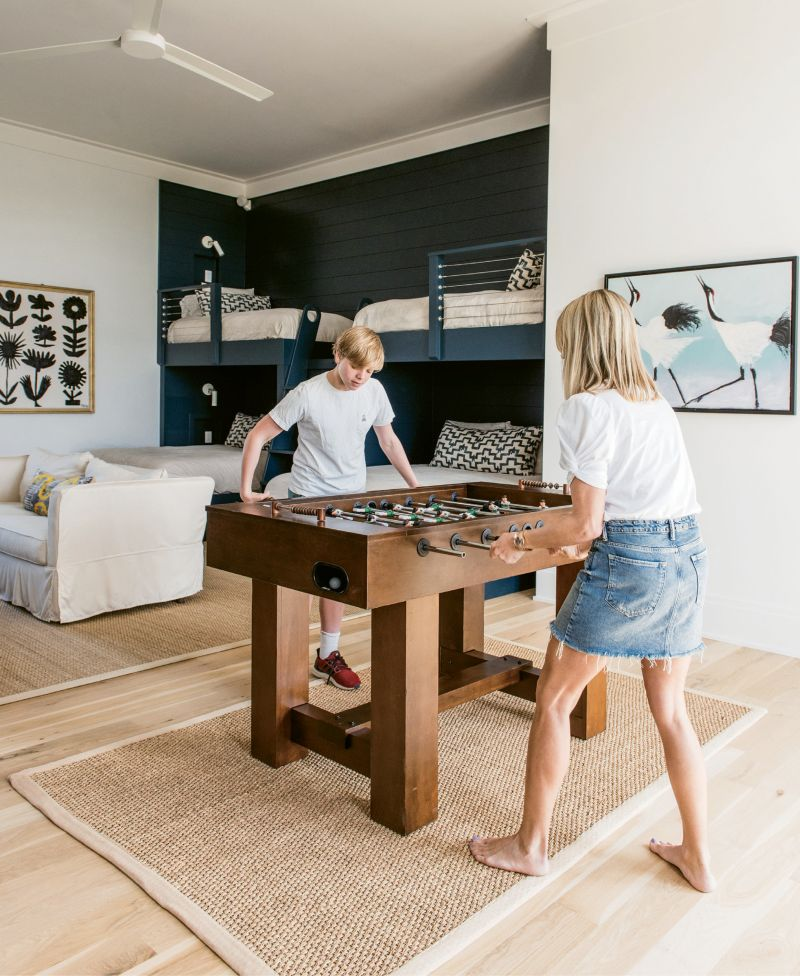 Boasting a foosball table and big-screen TV, the bunk room—which is situated between the children's rooms on the top floor—is a dream for sleepovers. Even so, its full bath, balcony access, and quartet of comfy beds make it equally inviting to visiting adults.