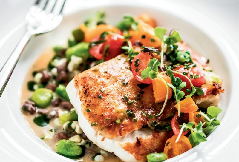 The catch-of-the-day served with seasonal vegetables