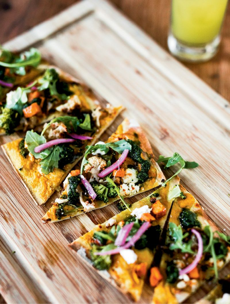 Fresh Slice: Seasonal produce shines in a vegetarian flatbread with curry cauliflower purée, sweet potatoes, broccoli, cauliflower, and goat cheese.