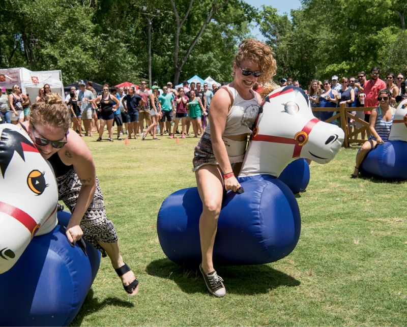 Festivalgoers got competitive during  the hilarious pony hop race.