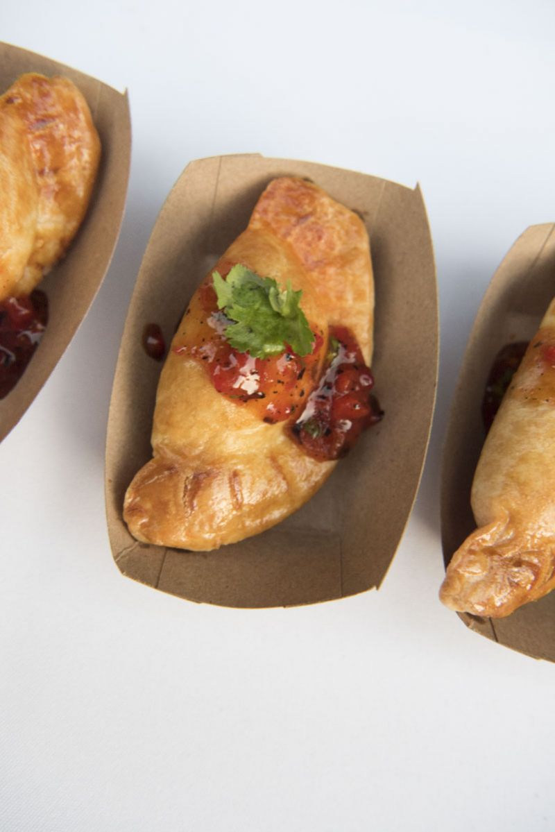 Brisket empanadas with sweet chili sauce from Lewis BBQ