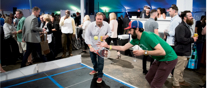 Guests got competitive while playing miniature tennis.