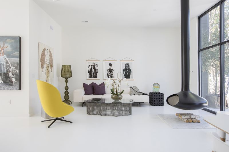 The living space with a suspended fireplace from Fireorb