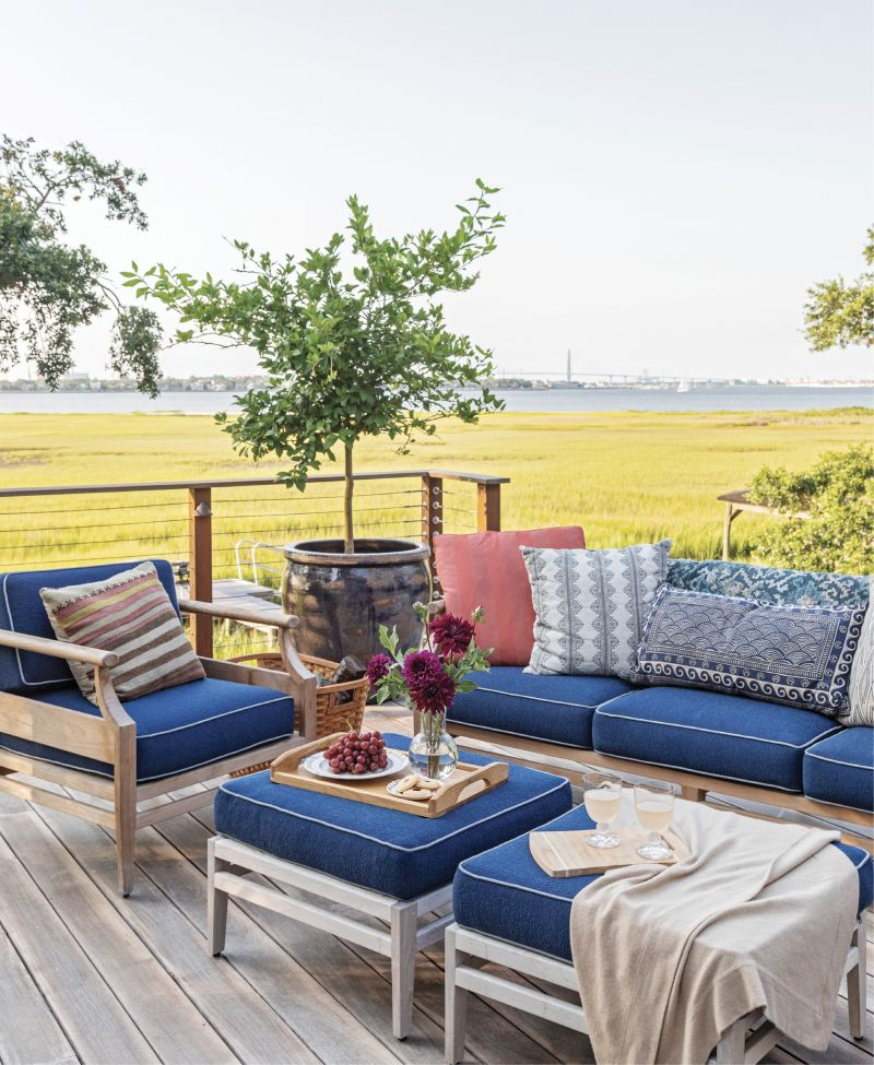 LOUNGE GOALS: The spacious deck takes full advantage of views of the Ravenel Bridge and the peninsula with ample spots to sit and soak up the scenery on comfy outdoor furniture from Frontgate or enjoy an alfresco dinner from the outdoor kitchen's Kamado Joe ceramic cooker.