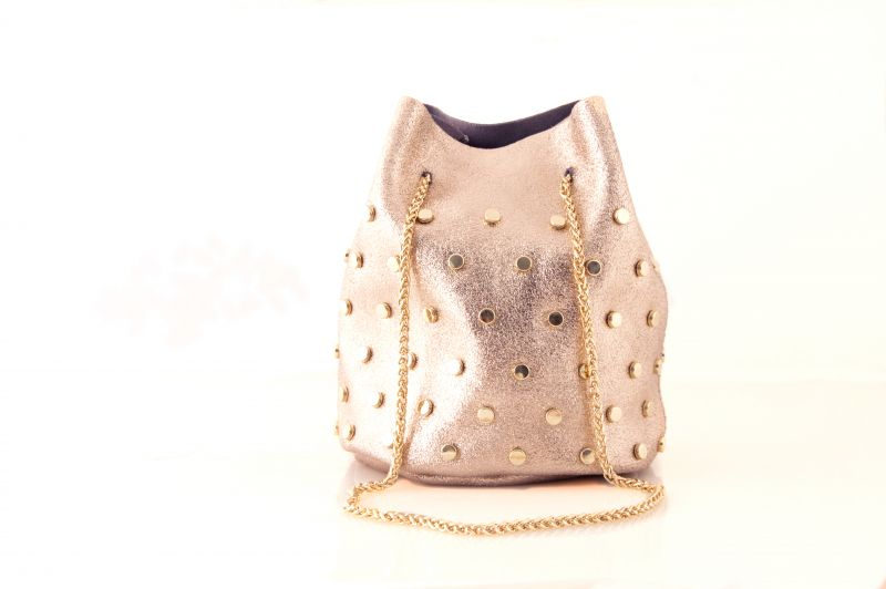 Suede bucket bag in rose gold, $78 at V2V