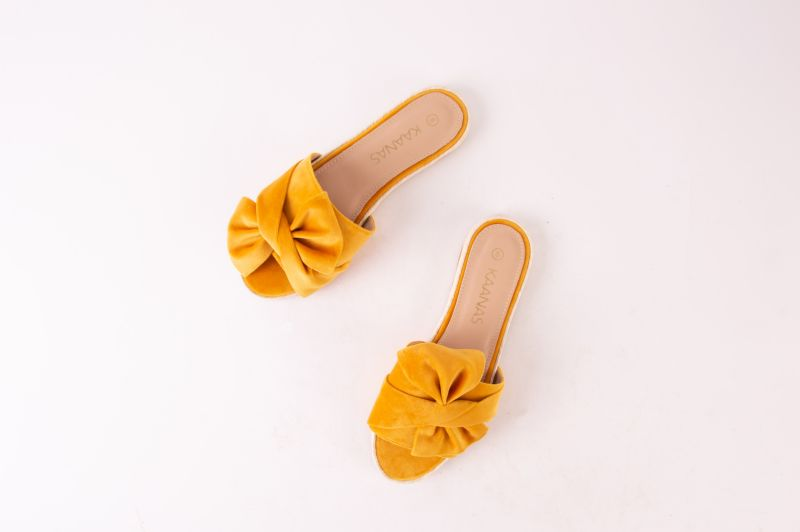 "Kaanas espadrille slide-ons in ""marigold,"" $108 at Maris Dehart"
