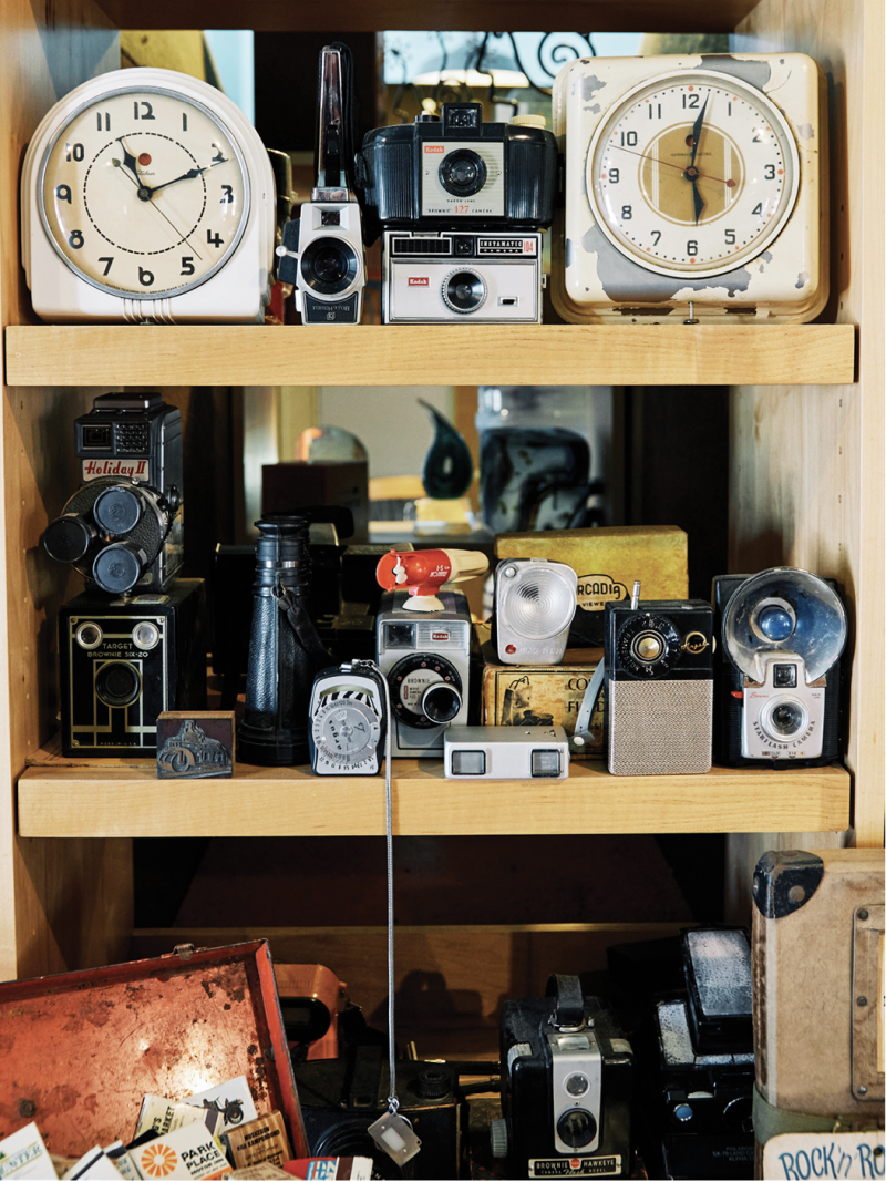 EBay finds, such as vintage alarm clocks and matchbooks displayed around the studio, fuel his inspiration.