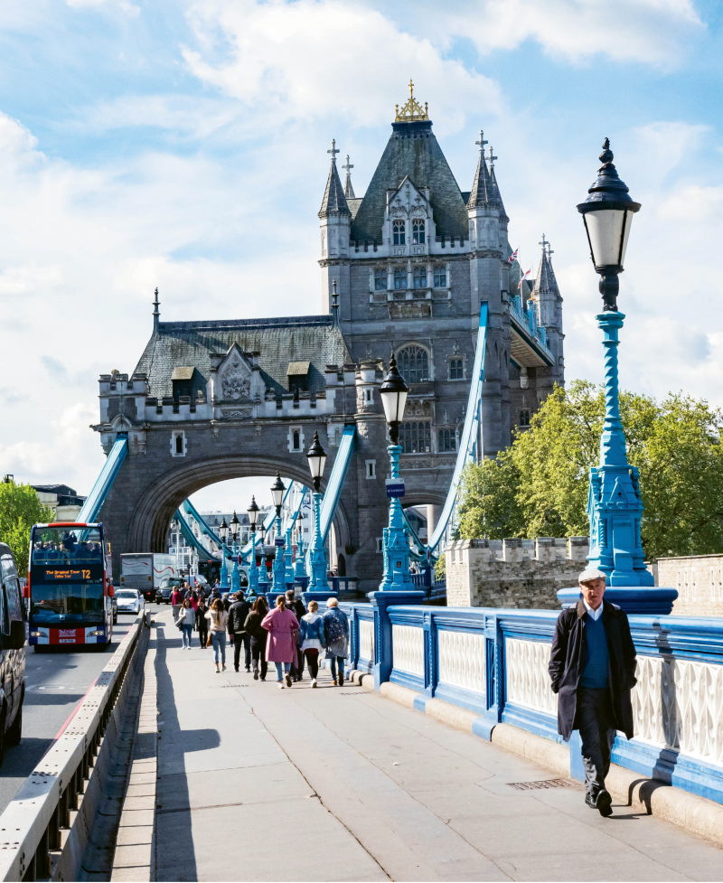 Walking the pedestrian path of the Tower Bridge, which spans the River Thames and is open for tours of the upper tier and engine room.