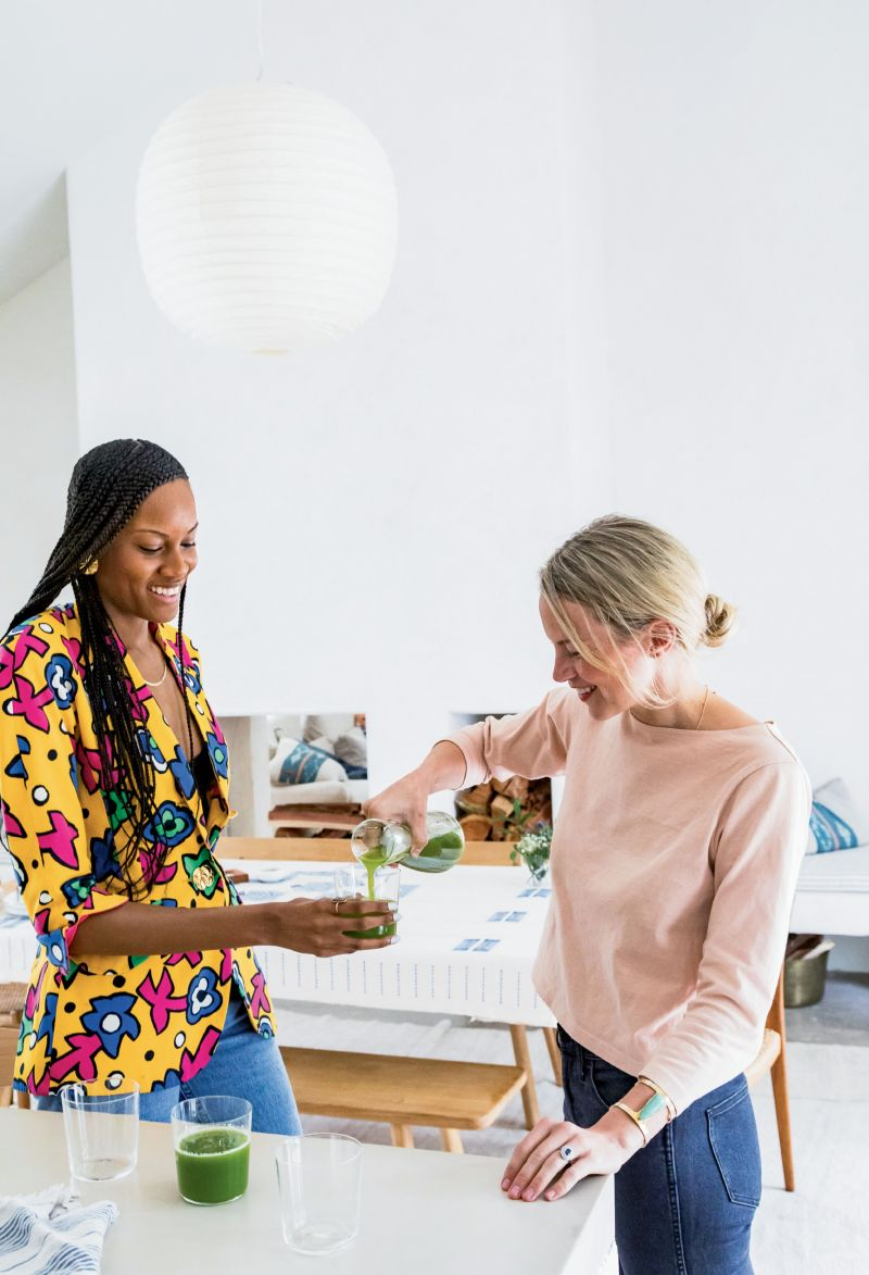 including Sabrina Hyman (left), cofounder of Ill Vibe The Tribe artist collective, and Kate Towill (right), co-owner of Basic Kitchen, who brought the restaurant's freshly pressed Apples to Apples juice.