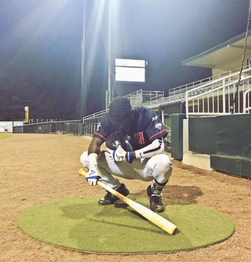 Chris at the Lexington County Baseball Stadium, bowing in prayer before a game on the one-year anniversary of the Emanuel shooting.