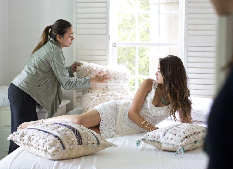 Stylist Andrea Serrano fluffs prop pillows from Celadon.