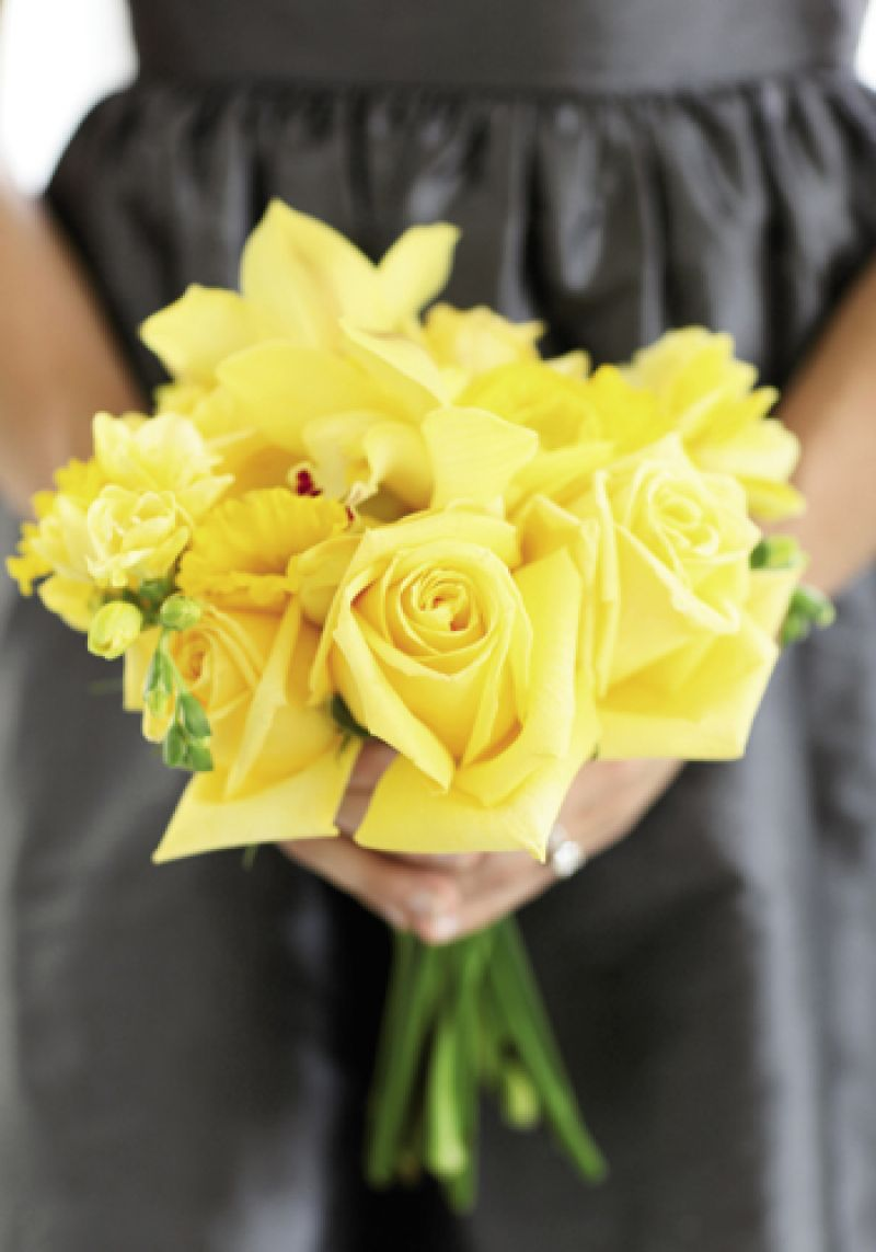 GOLD RUSH: Stems fashioned bouquets of yellow daffodils, freesia, orchids, and roses, made all the more vivid by the bridesmaids' charcoal-colored LulaKate dresses.