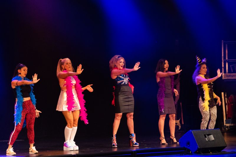 "The Spice Girls perform the group's classics, including ""Wannabe."""