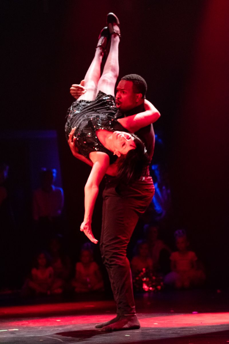 Naquan Villega of Dance Lab gives Susan Pearlstine a lift.