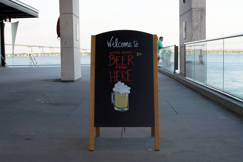 A chalkboard sign announces the party, welcoming guests as they arrive.