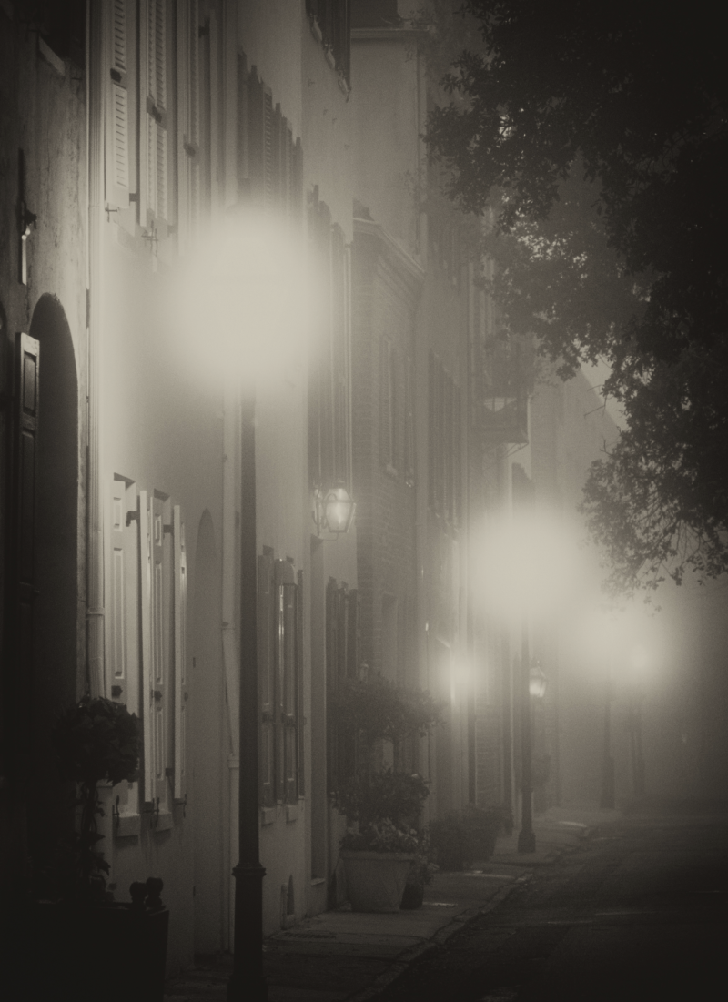 Street lamps glow at dawn along Elliott Street in the Historic District.