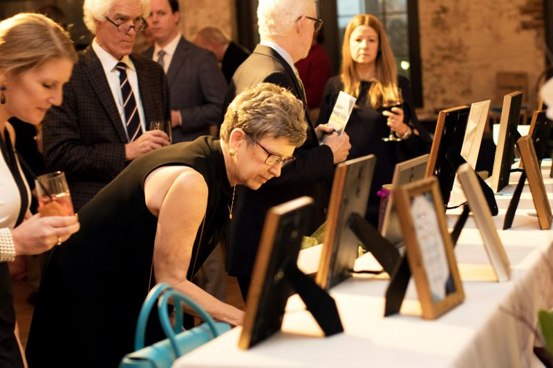 Guests surveyed the silent auction's many fine prizes.