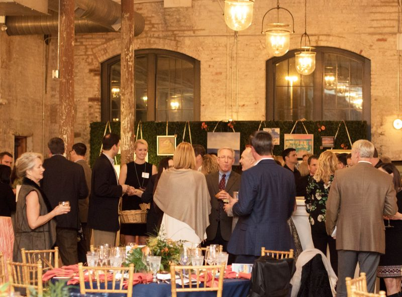 Attendees mingled in the beautiful Cedar Room.