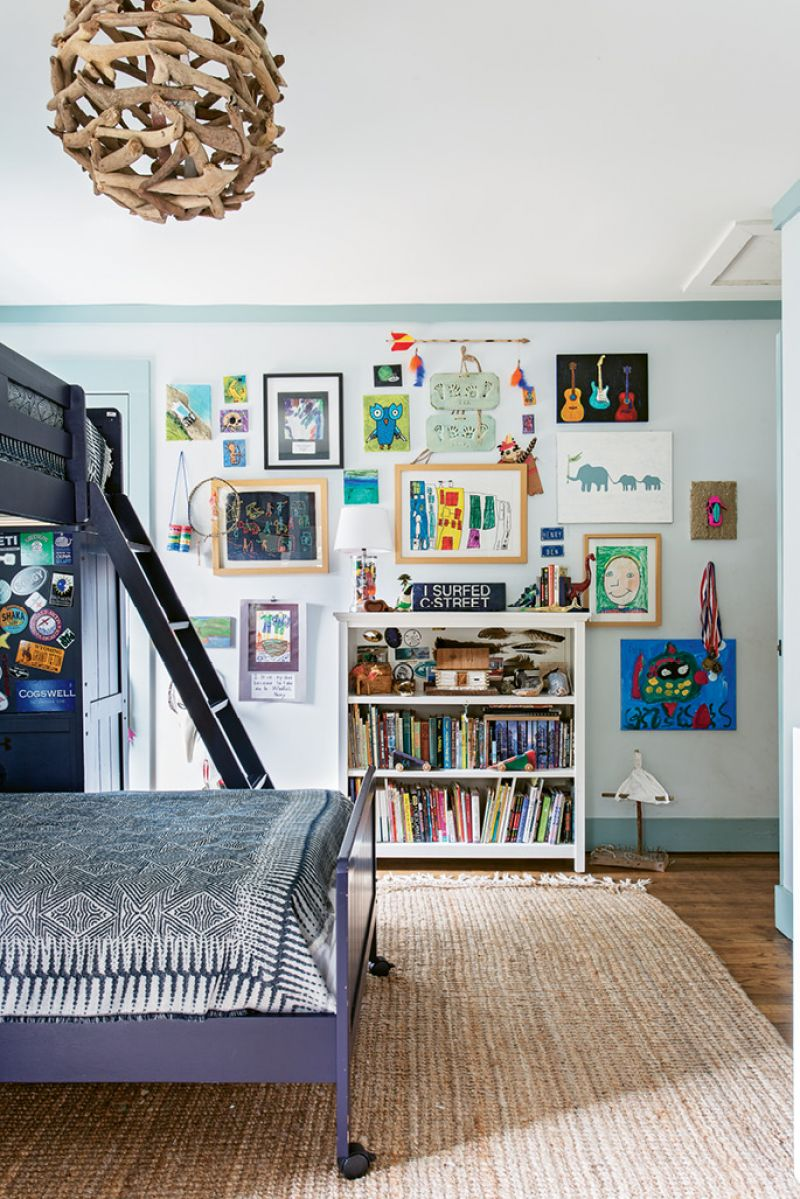Ben and Henry's room features a gallery wall with the boys' own artwork, as well as handicrafts they created at Huck Finn School in Mount Pleasant.