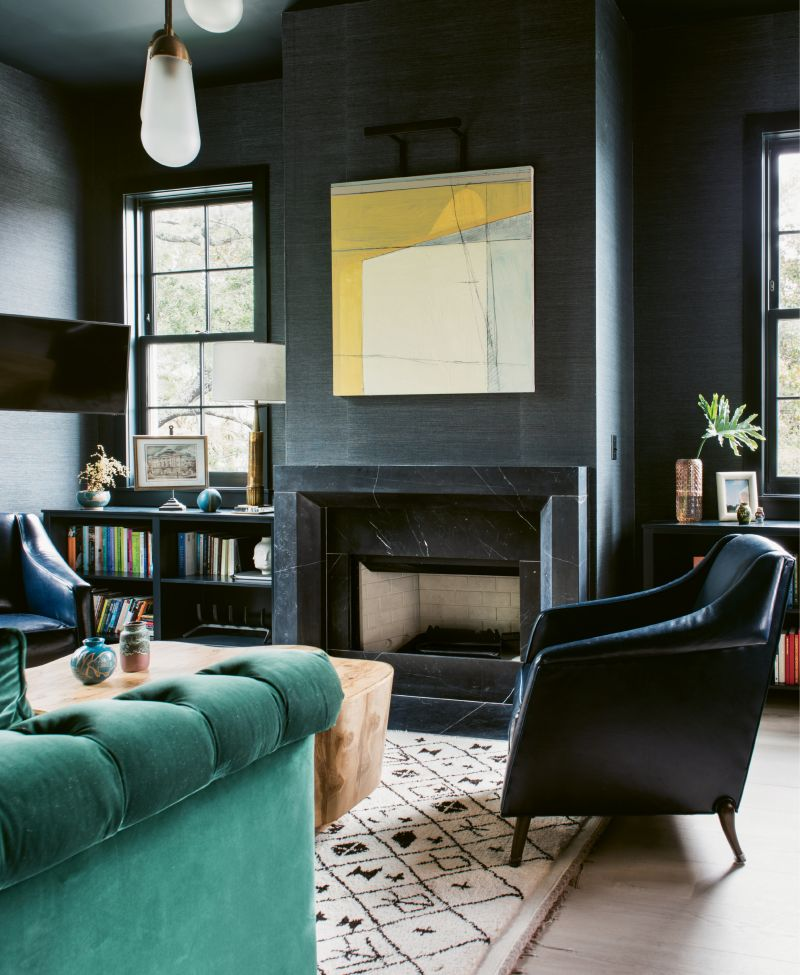 Over the fireplace, an abstract by artist Frank P. Phillips adds a dose of color.