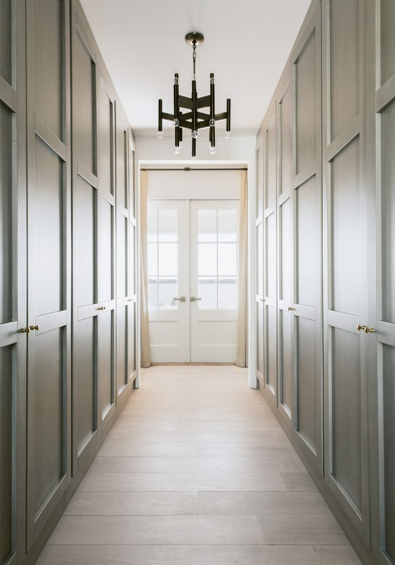 Even the his-and-her closets, which separate the bedroom and bath, provide harbor views.