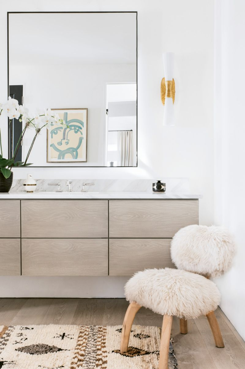 In the bath, floating custom cabinetry by Kris Kotlowski of Eurocraft Inc. echoes the cupboards in the kitchen.