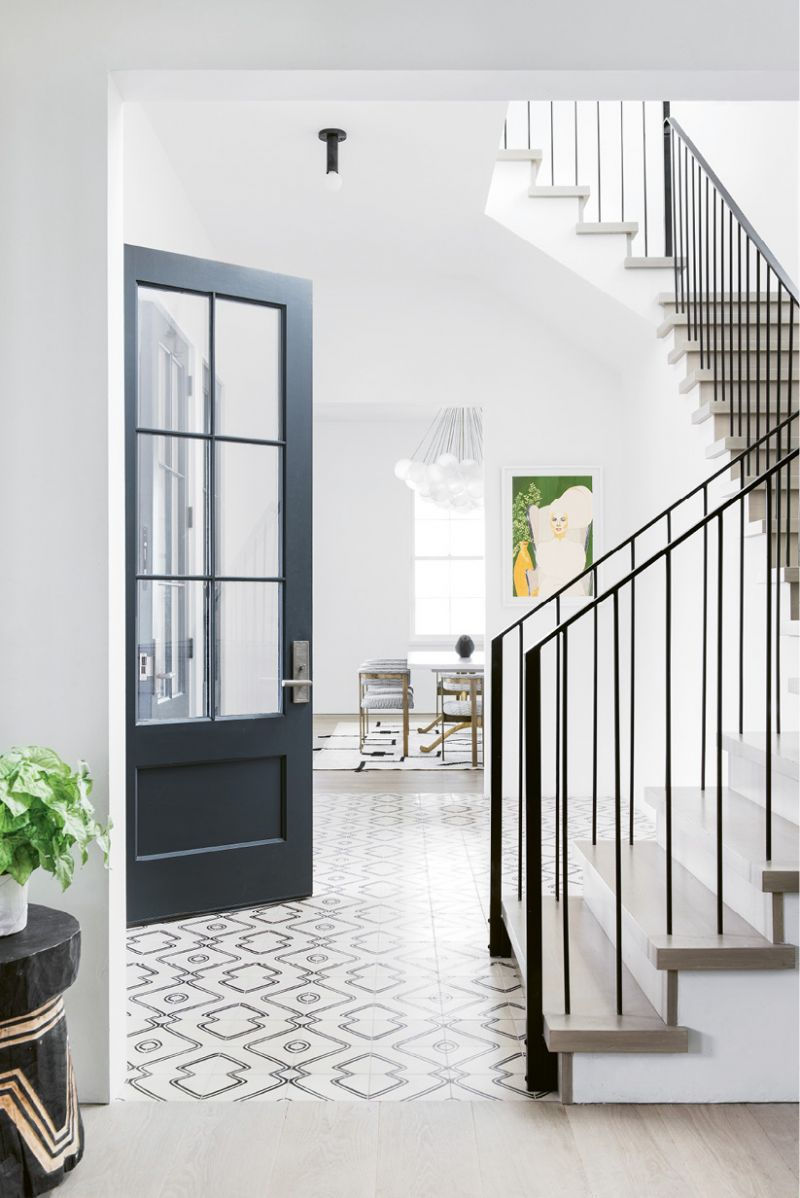 "In this informal entry, Exquisite Surfaces ""Commune"" cement tile in the ""Navajo Zebra"" pattern sets a playful tone. ""It's a lively welcome to the house via our side doors, which most friends and family use,"" Molly notes."