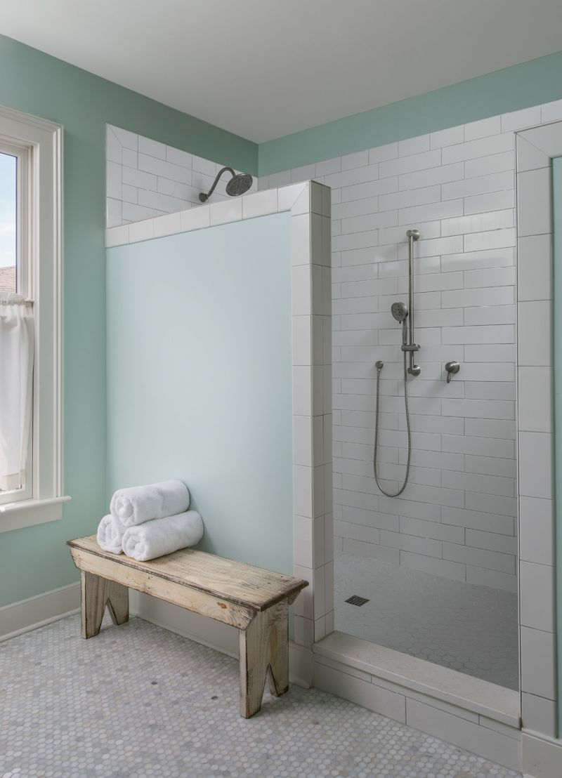 "A tiled shower with no glass door makes the bath low-maintenance. ""The design is a result of me hating to clean glass doors; I never wanted to see another squeegee again!"" Cindy laughs."