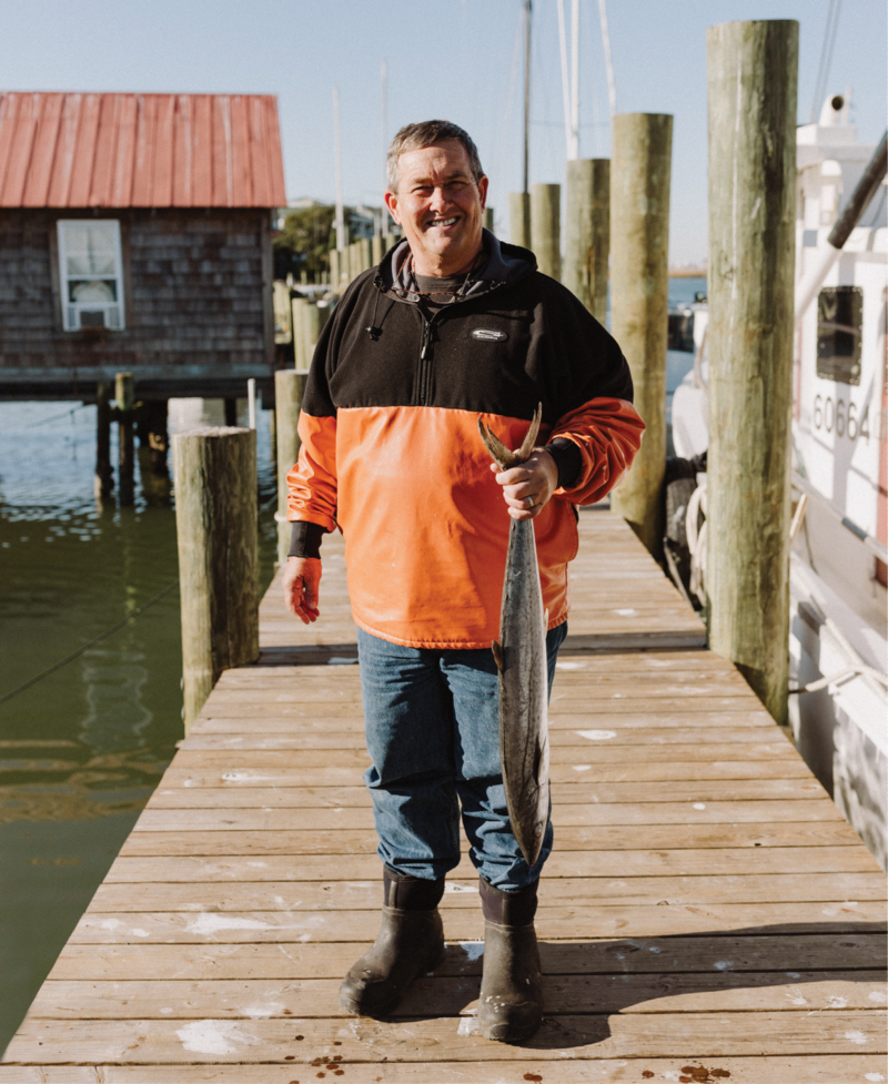 Local fisherman and Abundant Seafood owner Mark Marhefka with a king mackerel on Geechie Dock at Shem Creek