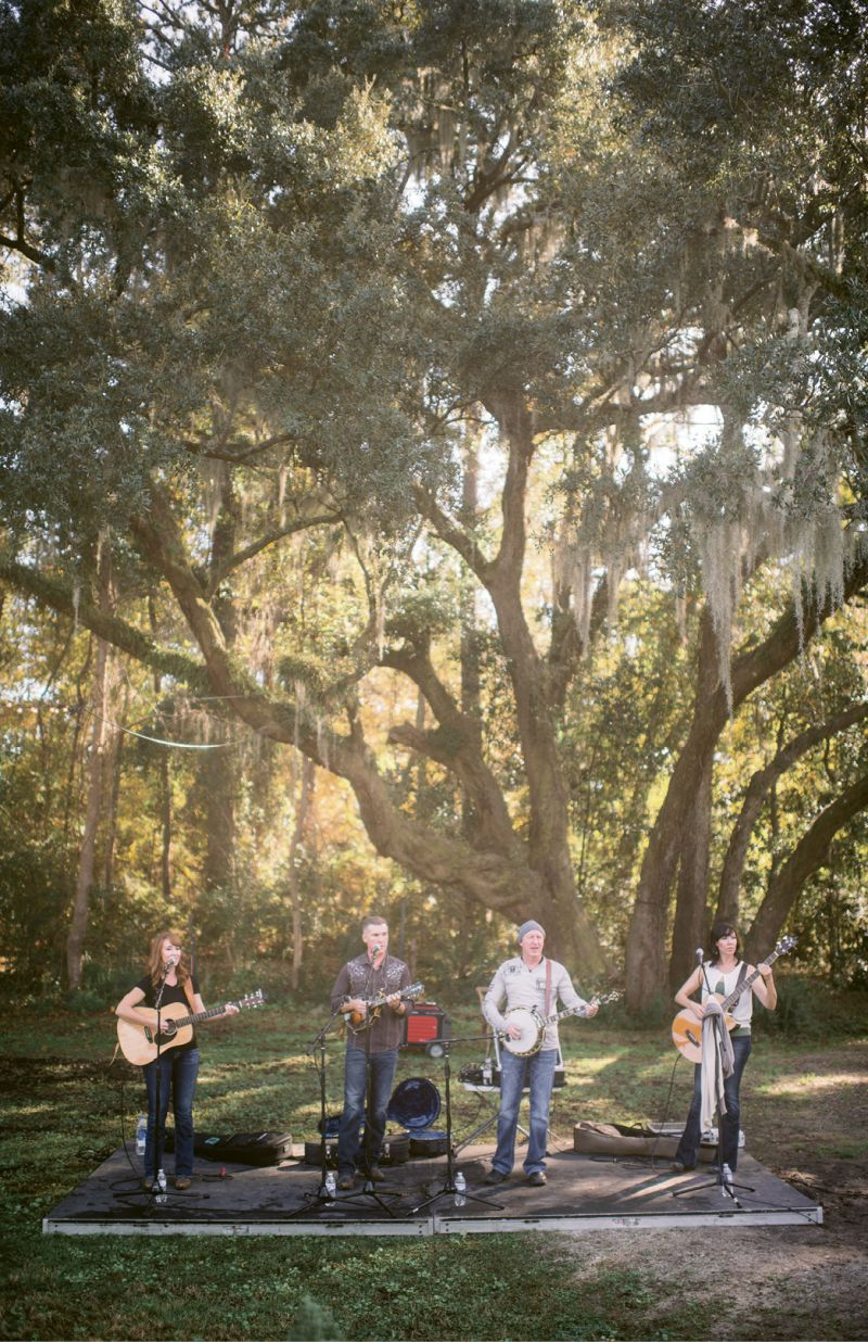 """Make Merry: Bluegrass band Common Ground played throughout the afternoon. """"The band was a splurge, for sure, but I felt it made all the difference!"""" says Melissa. When hosting a more low-key event, simply pipe in country or bluegrass tunes from a docking station."""