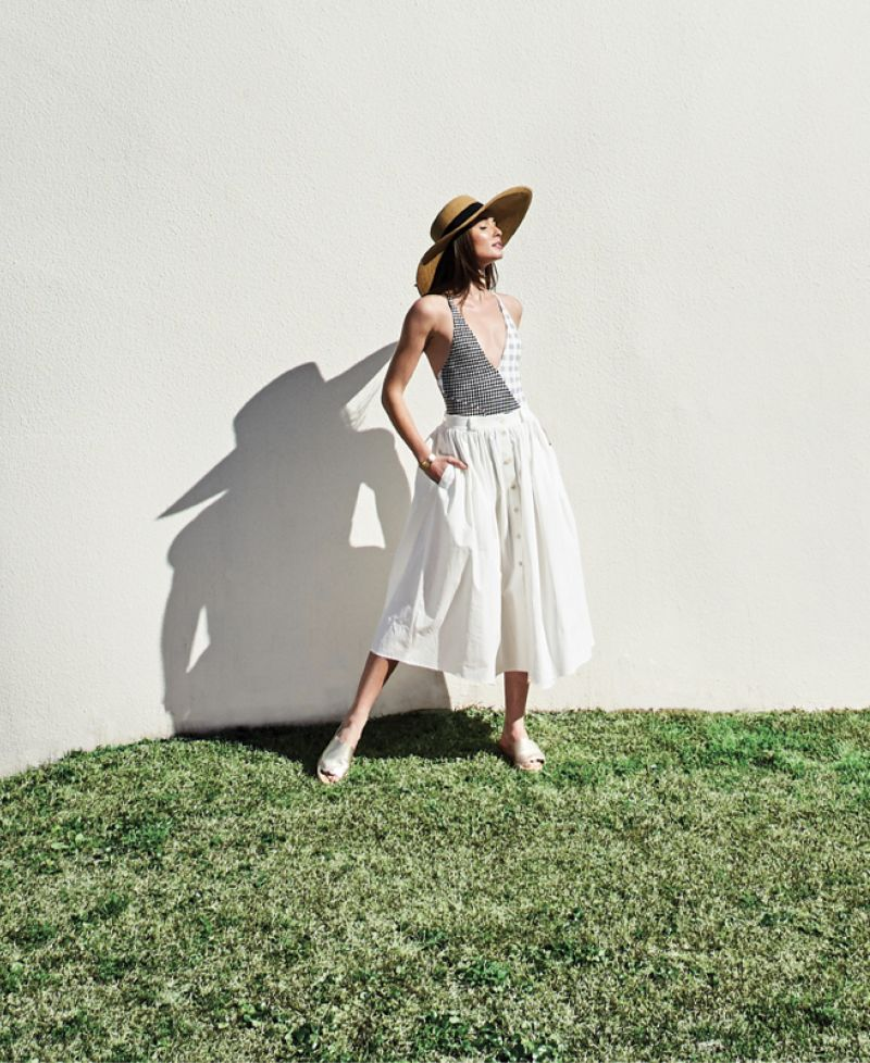 "SUIT UP - Marysia ""Suffolk Maillot,"" $359 at Everything But Water; Brock Collection cotton ""Olivo"" button-up skirt, price upon request at RTW; Gretchen Scott sun hat, $59 at Gretchen Scott; Kendra Scott ""Tenley"" 14K gold-plate cuff, $95 at Kendra Scott; Sam Edelman ""Andy"" leather slide in ""light gold,"" $90 at Shoes on King"