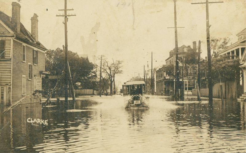 "1,000 Years of Floods: As these vintage images show, flooding in Charleston is nothing new. (Above) a pencil marking indicating ""1911"" suggests this car, sloshing down the street most likely near the corner of Rutledge and Calhoun, was a victim of the September 1911 flood."