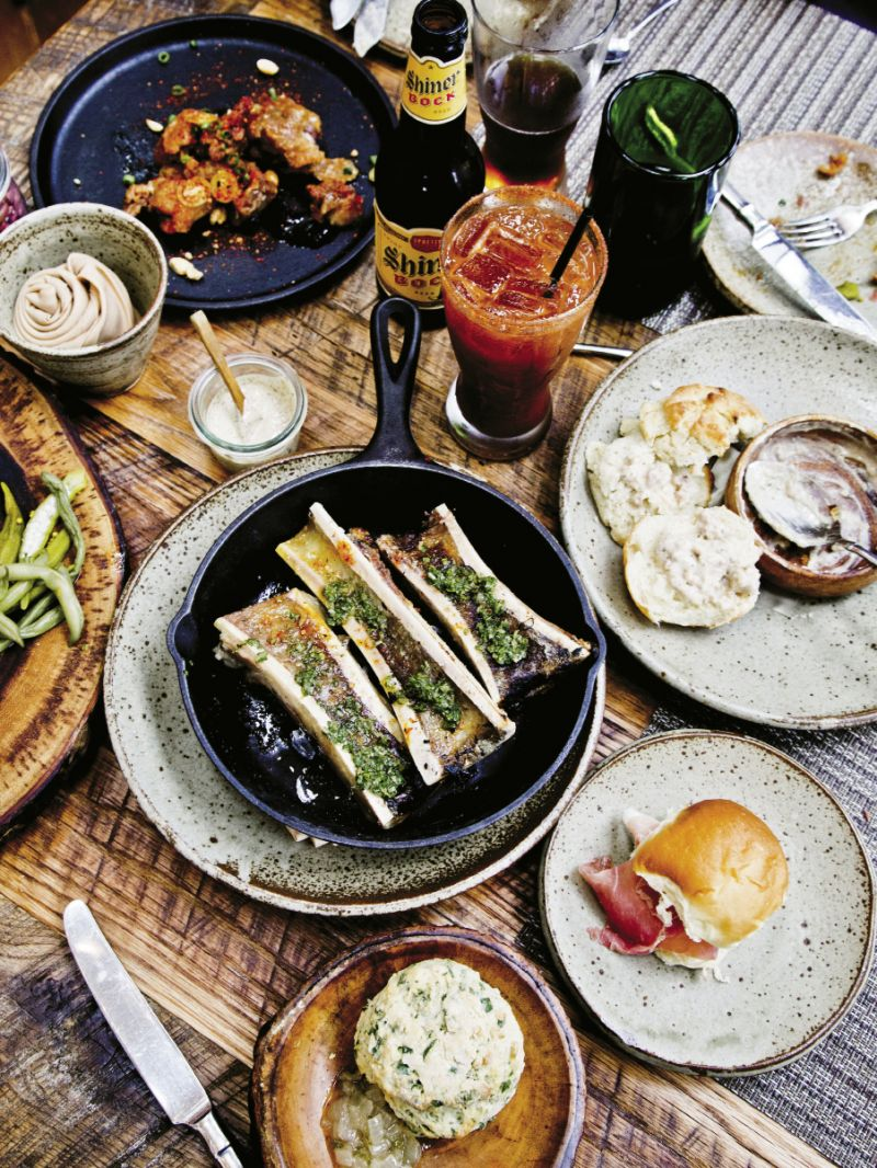 Brunch at Husk Nashville with a skillet of ember-roasted marrow, biscuits with sausage gravy, and spicy micheladas