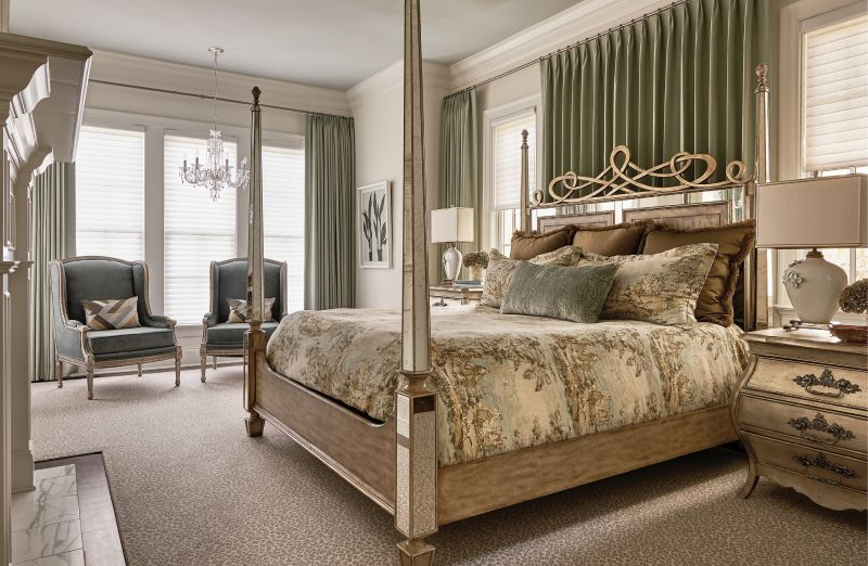 In the master bedroom, greens, golds, and beiges combine to create a soothing palette, with some playful features in the form of a leopard print Stark carpet and Zoffany velvet-covered antique French chairs.
