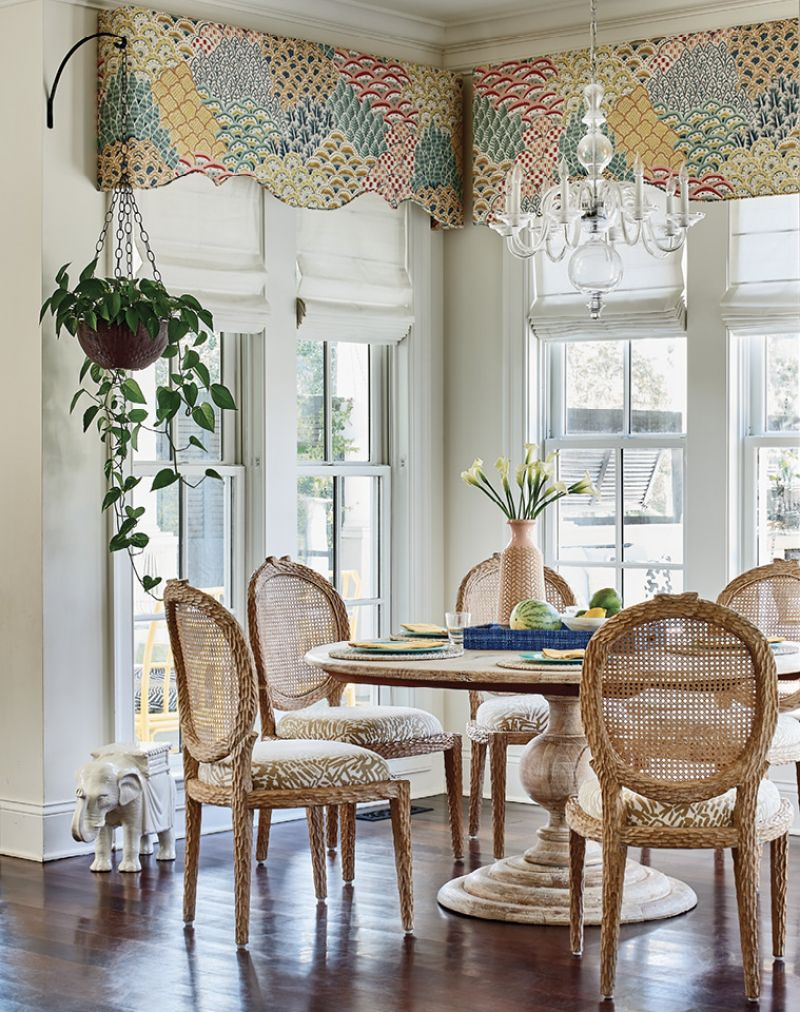 The drapery fabric from the living room appears again on the valances in the bright, white kitchen and breakfast nook.