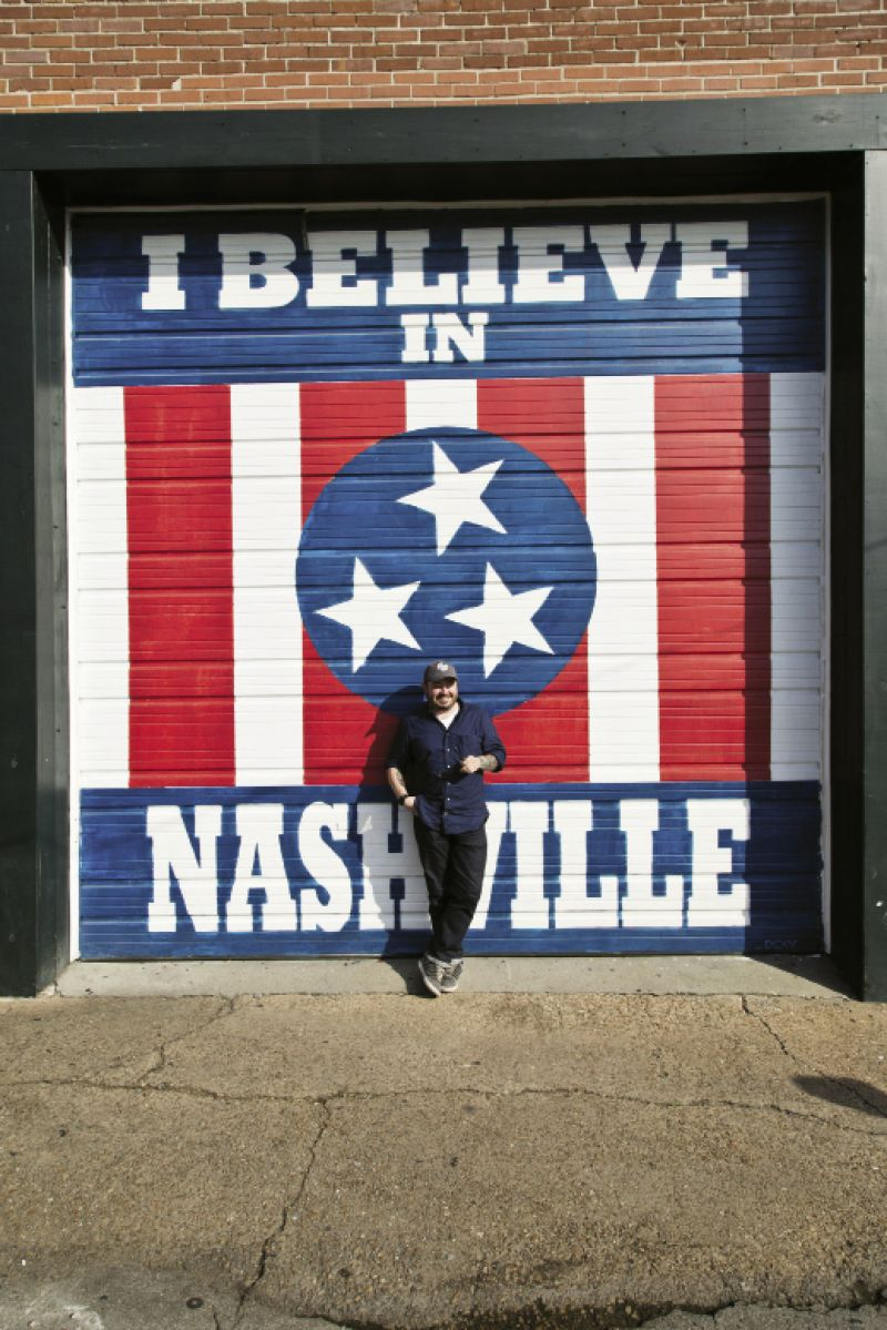While in Marathon Village, Brock stops in front of a mural by Nashville artist Adrien Saporiti.