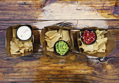 pick your poison: chips are available with queso, guacomole, and salsa