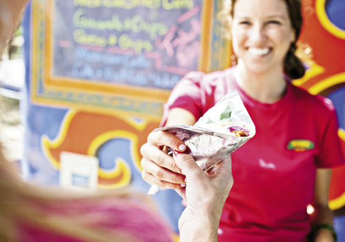 Courtney Parades hands out fare from the colorful truck