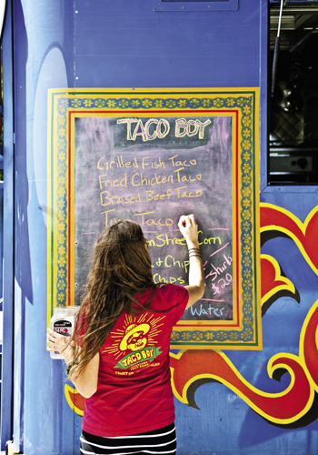 Parades writes out the day's menu