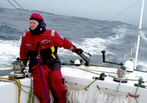 Brad braves rough seas in full offshore weather gear, including harnesses to strap himself to the boat
